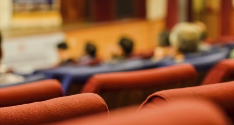Large group of students attending a seminar. Picture is taken as a blur.